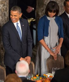 Michelle Obama in a Reed Krakoff cardigan and a Thom Browne dress. Getty Image