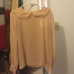 Blouse Sheer cream colored blouse with neck detail and keyhole. Tops Blouses