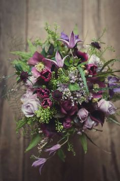 Jaw dropping gorgeous Spring bouquet with Hellebores, Clematis & Tulips image by Lissa Alexandra Photography www.weddingandevents.co.uk