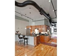 Industrial Chic Stove With Heater Shelf Exposed Duct Work