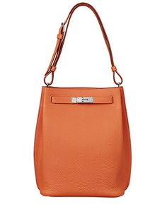 Hermes - So Kelly bag in orange leather. Front view.