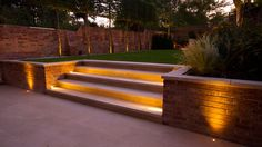 contemporary garden design I was asked to create a garden that offered a sense of classicism with a contemporary edge and that featured as large a lawn as possible. The house Back Garden Landscaping, Landscaping Retaining Walls, Sloped Garden, Backyard Patio Designs, Concrete Retaining Walls, Sloped Backyard, Back Garden Design, Garden Landscape Design, Contemporary Garden Design