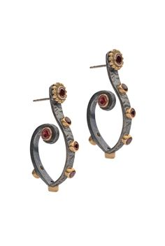 SAIGON HELLENIC EARRINGS Garnet  £60.00 - Now £50.00 Sterling Silver in Oxidized Finish with Brass details.  These garnet earrings are in hammered oxidized finishing sterling silver with brass details. The contemporary design features a very distinctive silhouette, reflecting the perfect balance between the orient and the west. It is a fusion of an oriental element with western Greek design, which makes this piece very classy and yet contemporary.  Length: 4cm from hook PRODUCT CODE: SAI28