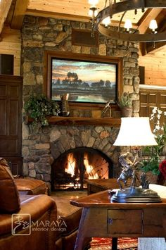 Love the stone placement over the door front & the front itself ~ Mountain Home Living Room with Stone Fireplace traditional living room