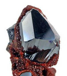 Hematite with Andradite Garnet from Wessels Mine, Kalahari Manganese Fields, South Africa [http://img.irocks.com/pics/k234a.jpg]