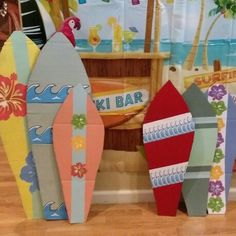 Check out these cardboard surfboards I made for my son's birthday party! Aren't they cute?