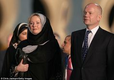 State visit: Foreign Secretary William Hague and his wife Ffion (left) arrive at the Sheikh Zayed Mosque in UAE.