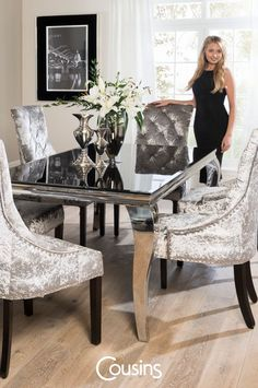 This eye catching dining set is sure to impress with its French styling, black glass top, velvet upholstery and curved steel legs.  The Catania dining table and chairs set boasts all of the practicality and striking design that any contemporary dining room needs. The table's thick glass table top is designed to complement almost any interior; its black tempered glass adds a unique design element whilst the high quality silver crushed velvet of the chairs gives luxurious touch…