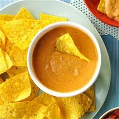 """Championship Bean Dip Recipe -My friends and neighbors expect me to bring this irresistible dip to every gathering. When I arrive, they ask, """"You brought your bean dip, didn't you?"""" If there are any leftovers, we use them to make bean and cheese burritos the next day. I've given out this recipe a hundred times. —Wendi Wavrin Law, Omaha, Nebraska"""