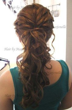 I've always thought about just having my hair UP on my wedding day. A dressed up ponytail:)