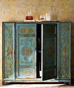 Teal and gold Moroccan style wooden cabinet, painted by hand, from Horchow. Im in love with this color