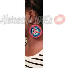 "One of a kind earring. Made of perler bead material w/hypoallergenic ear hoop. Approx 2"" in diameter - .004oz. in weight. 