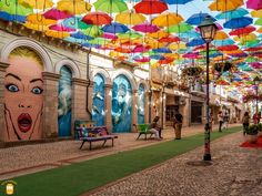 Visit Águeda and discover the amazing Umbrella Sky Project and other forms of street art. #portugal #agueda #centralportugal #umbrella