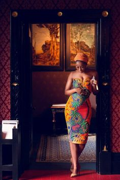 ▷ 1001 + ideas of stylish African print and how to wear it woman standing in the doorway, wearing a dress, african print, orange headscarf. African Fashion Designers, African Inspired Fashion, African Print Fashion, Africa Fashion, Ethnic Fashion, Look Fashion, Fashion Outfits, African Print Dresses, African Wear