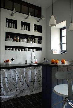Cool idea: niches for storage instead of open shelving Marianne Evennou Kitchen Paris | Remodelista