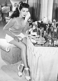 Ann Miller c. 1945 vintage fashion style pin up girl model movie star 40s shorts sweater wedge sandals shoes white photo print ad