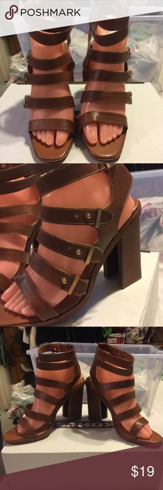 Brand New Strapy Heels Brand new brown strapy sandals in size 9. Made of brown faux man-made leather by Bumper. They are really cute and the straps buckle into a mini gold ball. They look really sexy on your feet and are extremely comfortable. Bumper Shoes Sandals