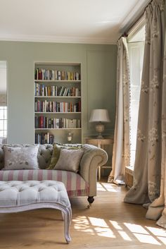 Always use 3 colours in a room and in this case damson, green and beige are the perfect relaxed combination. A sitting room which oozes with personality. The chesterfield woollen sofa is covered in a NEW colourway called 'Lichen'.