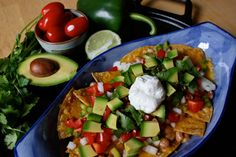 Nachos - Instead of junk food chips and canned imitation cheese sauce, these nachos are made with freshly-baked tortilla chips and loaded with healthy toppings. #BigGame #TeamBeachbody