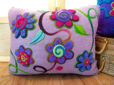 Lavender felted cushion with bright flowers and blanket-stitched edge, recycled renewable resource made with needle felted flowers of Nepalese and merino wool. Hamsterville on Etsy