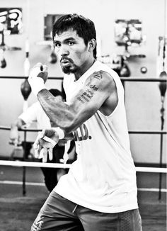 Manny Pacquiao- boxer, family man, catholic, political leader...