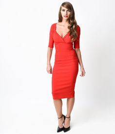 Trixie is a devastator, darlings! Taking bold cues from the sultry vintage dresses of the silver screen, Trixie is a captivating pencil dress in vibrant red. This pliable stretch bengaline frock boasts a gathered surplice sweetheart bodice, flattering half sleeves and banded natural waist. A darted and vented wiggle skirt clings to knee length and zips slyly up the back. Trixie is a triumph!  <br />Available in sizes S-2X while supplies last.<br />Size run displayed in UK sizing - Please…