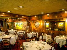 Beautiful wood paneling, arches, and '60s era drop ceiling. At Le Rivage, Midtown, NYC.