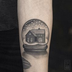Snowglobe with tiny house | Sven Rayen, Sinsin Tattoo; Antwerp, Belgium. Delicate lines in incredibly realistic black and gray