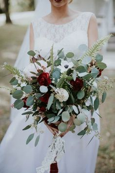 Pretty marsala, ivory, and matte green wedding bouquet | Image by Emily Magers