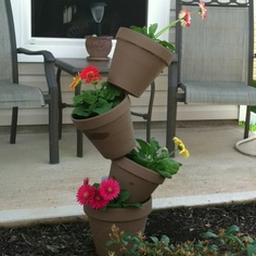 Tipsy Pots - My first Pinterest project.  4 terra cotta pots with a rebar down the center.  So simple!