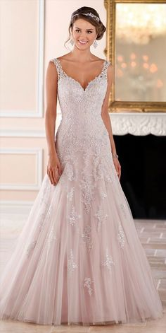 This sparkling silver lace wedding dress from Stella York is sure to be a show-stopper! The modern modified A-line silhouette boasts metallic lace that flows down from the Diamante covered bodice onto a light-as-air tulle skirt. The sweetheart neckline and illusion lace straps create an organic-edge neck that will flatter any bride-to-be! Sparkling crystal bead work brings attention to the bride's face while the tulle skirt adds drama and dimension to the look.