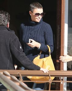 Charlize Theron shows off salt and pepper buzz cut as she lunches with friends - The Promethius actress wore a boxy blue turtleneck and loose cropped jeans