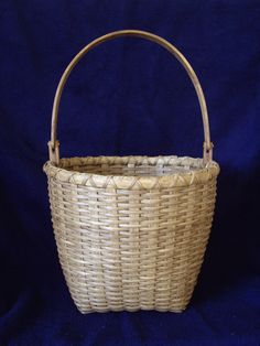 Rattan basket. Not sure it is shaker with that handle.