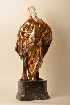 "Prof. Otto Poertzel (German:1876-1963). A gold gilt bronze and ivory sculpture of a lady. Signed ""Prof. Poertzel"". Height of figure 20"". Overall height 24 1/2 ""."