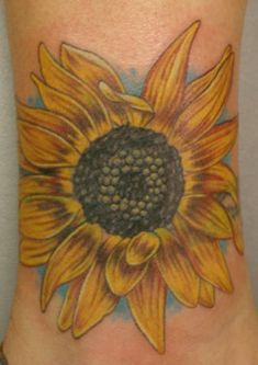 Possibly a cover up on my ankle to honor Char maybe not this exact one but an idea.   Big Sunflower Tattoo