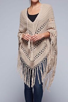 This bohemian inspired crochet poncho has a long tassel tie in front and long…