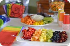 Rainbow-themed Birthday Party ideas: food, decorations, treat bags, etc.