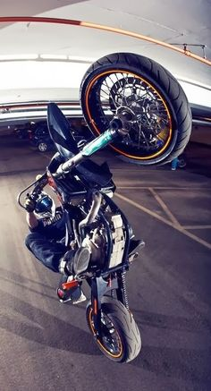motorcycle poppin' a wheelie straight up