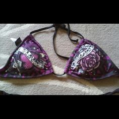 Limited Edition RARE Crystal Sinful Bikini Top Reduced TODAY ONLY! New❤ without tags ( I ordered this online and it did not come with tags) limited edition extremely rare and impossible to find Sinful purple and pink heart and rose crystal jeweled bikini top, ties around the neck and back, has large square studs on side ties, so absolutely gorgeous and sexy! Sparkles so beautifully in the sun! Looks great with any black, purple or pink bottom. I also have the same one available in a size…