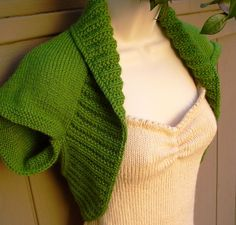 """This Green Apple Knit Shrug is made from medium weight yarn. It has garter stitch arm holes, with 4 moss ribbing around the body. This soft vest looks and feels great. This bolero would be a great gift idea or as a present to yourself. Size: 36"""" to 38"""" Bust Generally fits size 8 to 10 This is a great item for tweens, teens and adults. There is no seam down the back, plus your back will be half or 3/4 covered by this shrug, depending on your shape. The yarn is 100% Acrylic and can be…"""