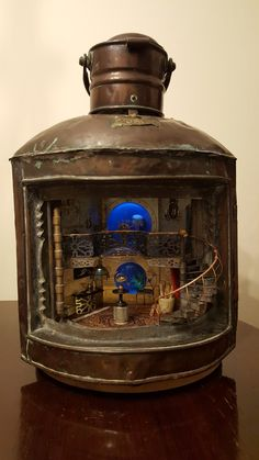 "Jules Verne's 20,000 Leagues under the sea, ""Nautilus"" interior inspired  Diorama, inside an antique ships lantern."