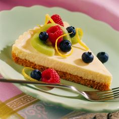 Lemon Spring Tart - Freshen up spring celebrations with this sweet and vibrant Lemon Spring Tart.  Topped with enticing seasonal fruit, this delicate dessert features fresh squeezed lemon juice in a velvety cream cheese filling atop a delightful graham cracker crust.  With its smooth texture and mouth-watering flavor, this tart is a refreshing treat for any special gathering.  http://www.verybestbaking.com/mobile/detail.aspx?id=132915