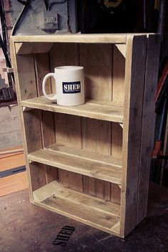 Wooden crate with shelves.