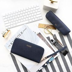 Sleek and highly practical to fit all your essentials in one.⠀ . . . #wallet #pencilcase #navy #monogram #leather #aesthetic #vsco #vscocam #instadaily #flatlaysg #flatlay #flatlaystyle⠀