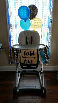 Wild one first birthday party. Cake smash banner. #HighChair