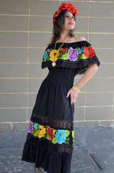 Beautiful Mexican embroidered dress off shoulders with embroidered (machine) multicolored flowers and crochet lace edges.    Has elastic to