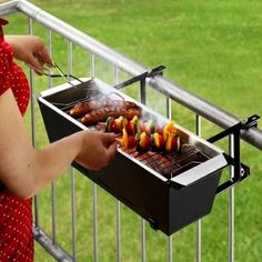 Of course you could continue using your little Hibachi or mini Weber.  But all that bending over! Not so with the rail hugging BBQ Bruce. The Bruce offers comfortable waist high charcoal grilling for those restricted by vertical dwelling space. No more achin' back from bending and flipping.  Available throughlivingtools.de for about $65.00, the Bruce comes apart for easy cleanup and stowing. VIA