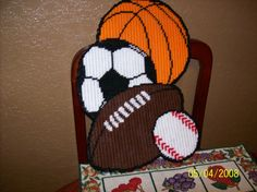 $12-Hand Crafted Plastic Canvas Sports Balls Theme