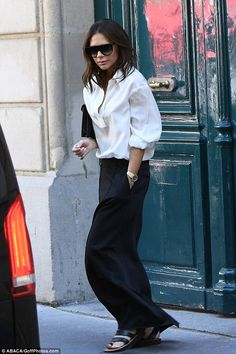 Chic: Victoria Beckham was flying solo on Saturday, as she stepped out in Paris while shunning her beloved high heels in favour of simple sandals