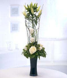 Birthday Flowers - Flower arrangement in white and black. Very striking.